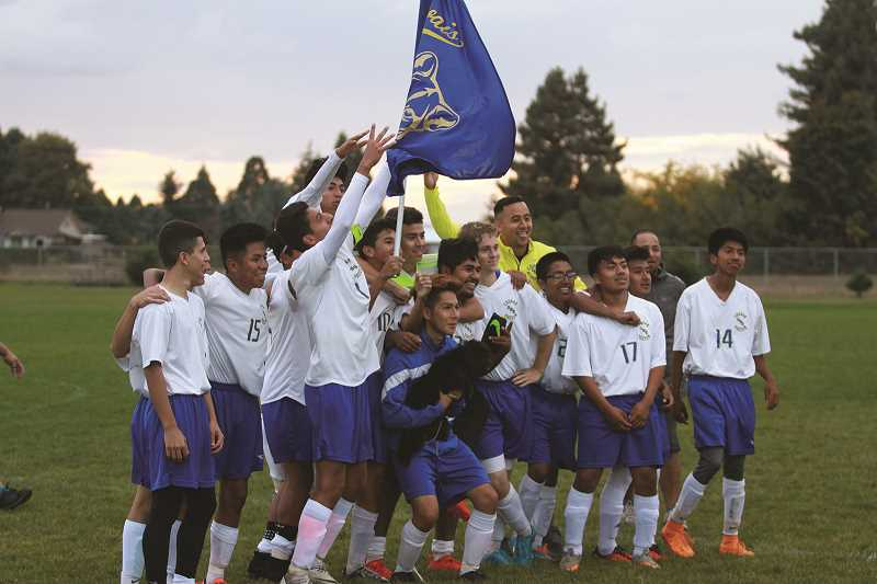 PHIL HAWKINS - The Gervais boys soccer team celebrates a victory in 2016 when the team went on to win the program's first conference title since 2008.