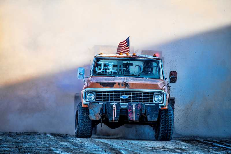 LON AUSTIN/CENTRAL OREGONIAN - Annette Anderson, of Forest Grove, drives Rust Bucket on Saturday at the Crook County Fairgrounds. Anderson's longest pull of the event was 278.70 feet. Her daughter normally drives the four-wheel drive truck.