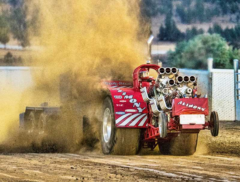 LON AUSTIN/CENTRAL OREGONIAN - Larry Pfenning finished second in the same division with a pull of 471.53 with his three-engine blown alcohol hemi tractor named Alimony.