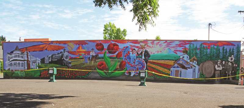 INDEPENDENT PHOTO: JULIA COMNES - The mural depicts images from Woodburn's culture and history, including the Settlemier House, Wooden Shoe Tulip Farm, Ballet Folklorico dancers and a Russian Orthodox Church.