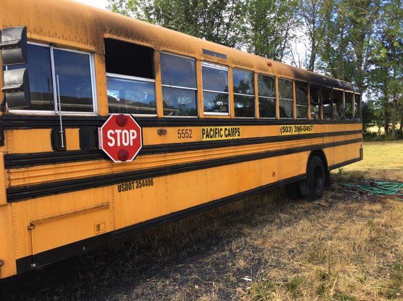 PHOTO COURTESY OF APRIL BURBANK - An arson fire destroyed this bus used by Pacific Camps St. Helens on Saturday, July 8. One minor has been arrested in connection with the fire.