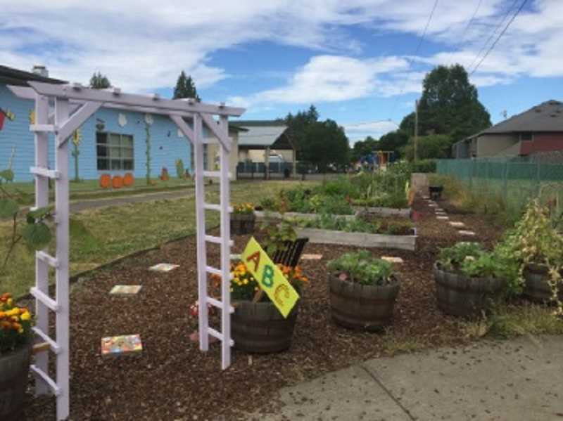 COURTESY OF CASEY BRENNAN - The garden at the rear of Hopkins Elementary has become a sanctuary, an outdoor classroom and a community resource as well as a landmark in the city thanks to hundreds of volunteer hours spent working on it each year.