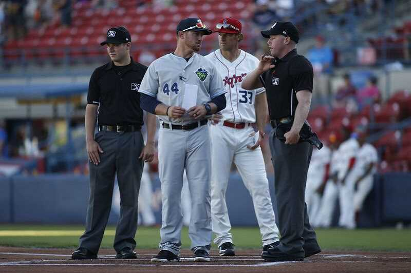 COURTESY PHOTO: MICHAEL JACOBS - Hops manager Shawn Roof converses with the umpires prior to a game in Spokane. Roof was ejected before the game with the Indians started July 7.