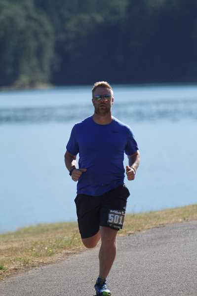 HILLSBORO TRIBUNE PHOTO: WADE EVANSON - Shawn Dodd, who finished second in the 5K off-road run at the Hagg Lake Triathlon and Endurance Sports Festival, runs the early stage of the off-road race July 9.