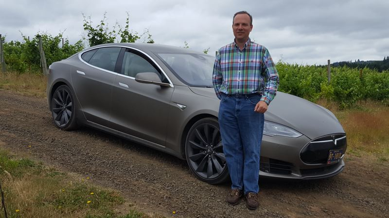 COURTESY PHOTO - Alfredo Apolloni of Forest Grove stands near his Tesla Model 6. Apolloni Vineyards is providing a specially-bottled Pinot noir vintage for Concours d'Elegance this weekend.