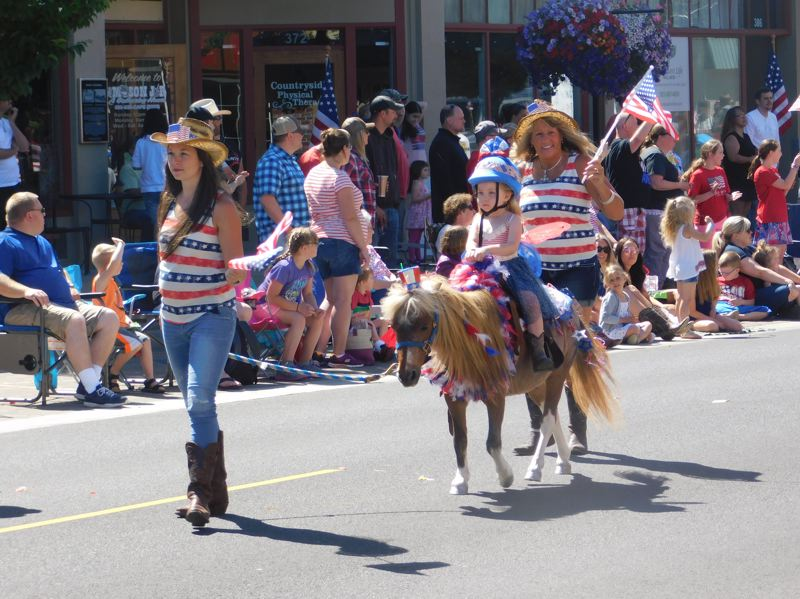 ESTACADA NEWS PHOTO: EMILY LINDSTRAND - The Estacada Fourth of July parade included young participants on tiny horses.