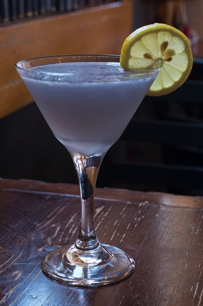 OUTLOOK PHOTO: JOSH KULLA - The Portland Sunshine martini at Troutini, with its purple-grey color and bright slice of orange, reminds staff of the sun trying to fight its way through overcast Portland skies.