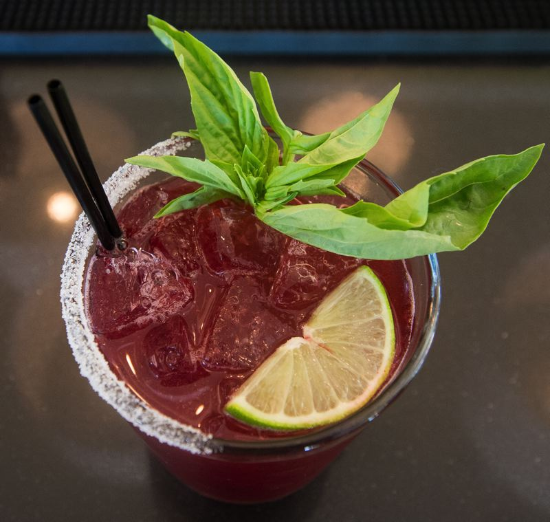 OUTLOOK PHOTO: JOSH KULLA - The blackberry basil martini is as colorful as mixed drinks come, with the green and red colors standing out and making the cocktail a customer favorite.