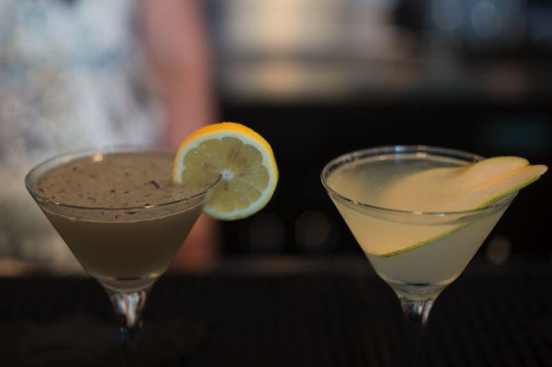 OUTLOOK PHOTO: JOSH KULLA - Elizabeth Baker stands behind the Portland Sunshine martini and the Peartini, two favorites at Troutini.