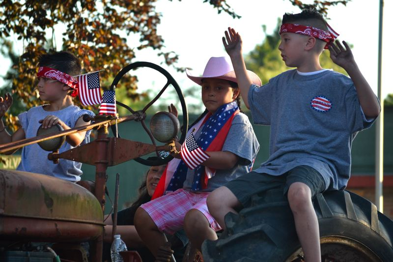POST PHOTO: BRITTANY ALLEN - Geren's Farm Supply stuck to what they do best with a rural Americana-themed float in Thursday's parade.