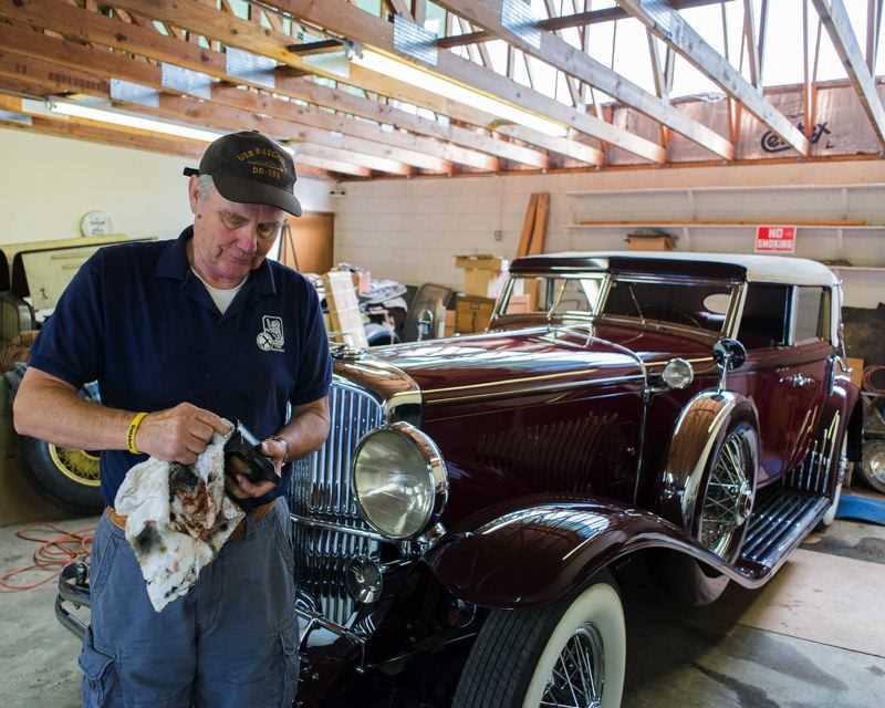 TIMES FILE PHOTO - Beaverton Resident Clifford Stranburg said he enjoys taking part in the Forest Grove Concours d'Elegancebecause of 'the history of it.'