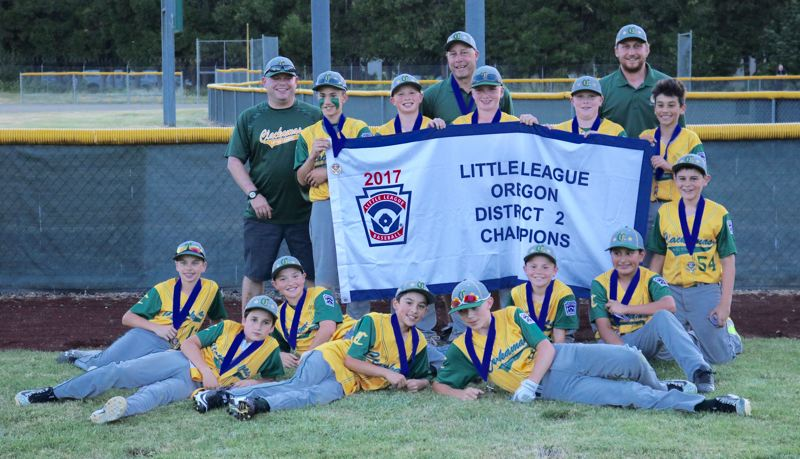 REVIEW/NEWS PHOTO: JIM BESEDA - Clackamas clinched the Little League Baseball District 2 championship with a 5-4 win Tuesday over Southeast Portland at Clackamas' Riveside County Park.
