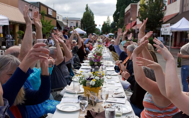 HILLSBORO TRIBUNE FILE PHOTO - Attendees at last year's Farm-To-Table Dinner in Hillsboro performed a 'stadium wave' to show their enthusiasm for the event. This year
