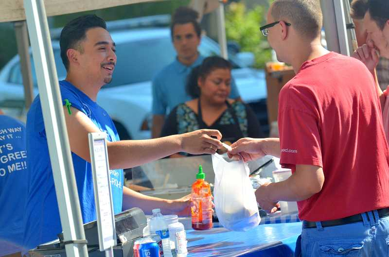 SPOKESMAN PHOTOS: COREY BUCHANAN - Perennial favorties like Getta's Gyros are a welcome addition to the Wilsonivlle Farmers Market.