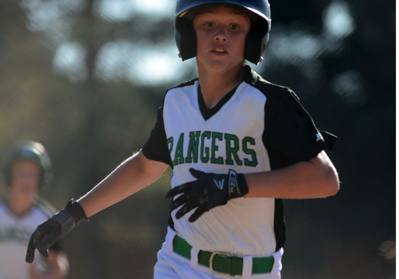 ESTACADA NEWS: DAVID BALL - Estacadas Andrew Riedel moves toward third base on his way to scoring during the teams 18-3 win over Milwaukie last Thursday.
