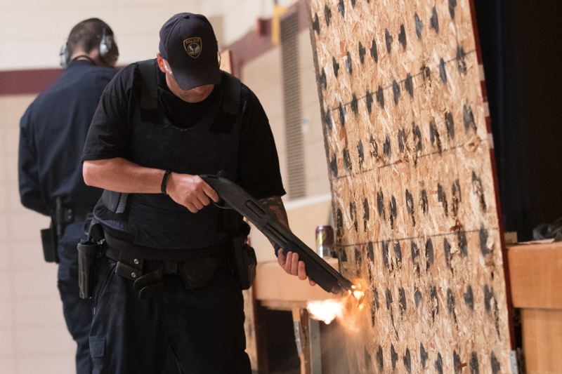 TIMES PHOTO: JAIME VALDEZ - Officers learn the best way to fire a gun into a door, or into a lock, to get the door open without endangering people within. For training purposes, they use 'frangible' ammo, which disintegrates upon impact.