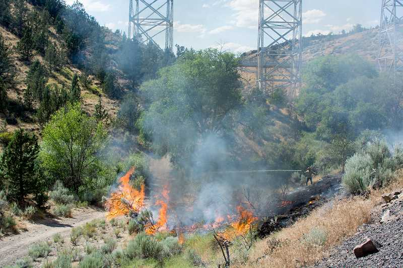 LINDA LARSON - The Canyon Road Fire in the Willow Creek Canyon under the train trestle, burned one-quarter to one-half acre before it was stopped by Jefferson County Fire District crews.