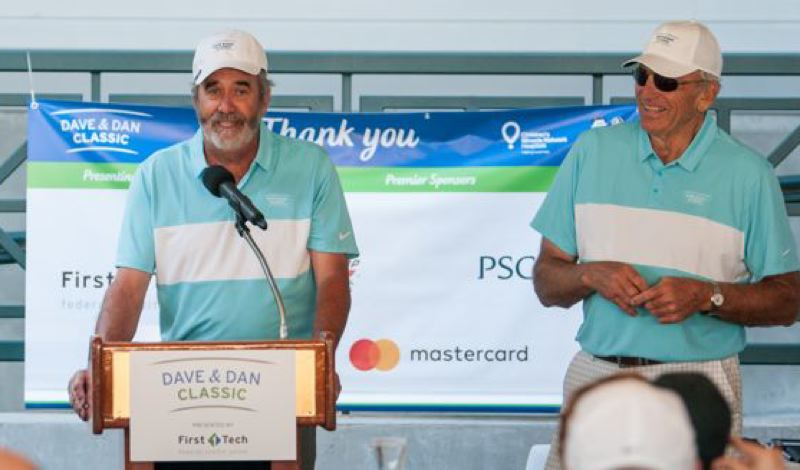 COURTESY: TREVOR POUND, PORTLAND-PHOTOGRAPHY.COM - Dan Fouts (left), former University of Oregon quarterback, and Dave Wilcox, ex-Ducks linebacker, speak as co-hosts of a benefit golf tournament Monday at Pumpkin Ridge.