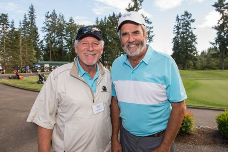 COURTESY: TREVOR POUND, PORTLAND-PHOTOGRAPHY.COM - Former University of Oregon football coach Mike Bellotti (left) and ex-Ducks quarterback Dan Fouts help raise money for hospitalized children at a golf tournament Monday at Pumpkin Ridge.