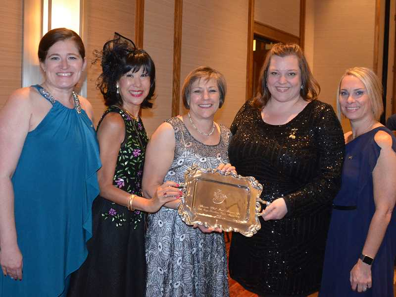 SUBMITTED PHOTO  - Maja Berge (second from left) and Susan Maxwell (center) represented the Lake Oswego-Dunthorpe Alumnae Club at the international convention and received awards for their chapter. With them are representatives of the regional team that supports the local alumnae club and nearly 40 other clubs in 12 Northwest U.S. states and Canadian provinces.