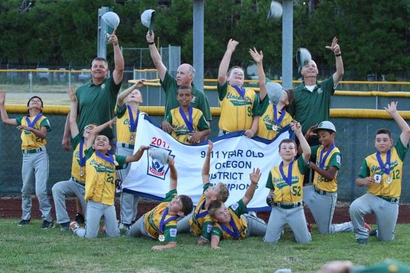 REVIEW/NEWS PHOTO: JIM BESEDA - Clackamas' 9-11 Little League Baseball team celebrates after clinching the District 2 championship with a 14-4 win over Southeast Portland Wednesday at Riverside County Park.