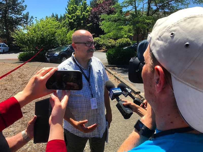 HILLSBORO TRIBUNE FILE PHOTO - Hillsboro Police spokesperson Henry Reimann speaks with media after an attempted hijacking July 3 at the Hillsboro Airport.