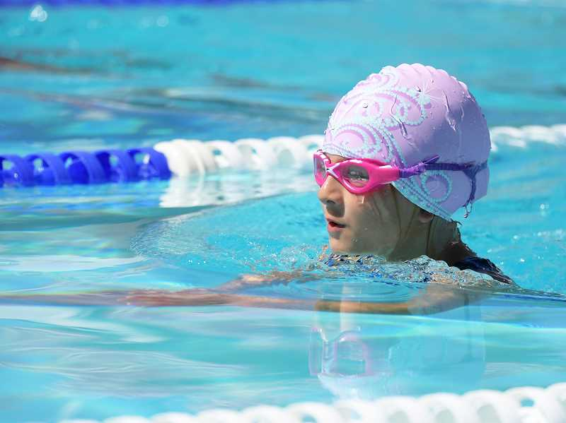 LON AUSTIN/CENTRAL OREGONIAN - Paige Wood swims the 25-meter breaststroke at the Prineville Invitational. Swimming in the 8U division Wood scored 16 points at the Jay Rowan Open, which was held in Redmond July 7-9.