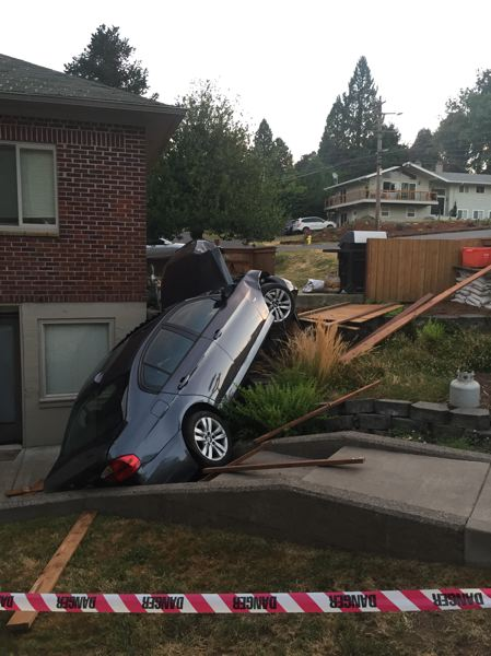 PHOTO COURTESY: MPD - This parked vehicle on Harrison Street was damaged by a suspect's SUV on Thursday evening.