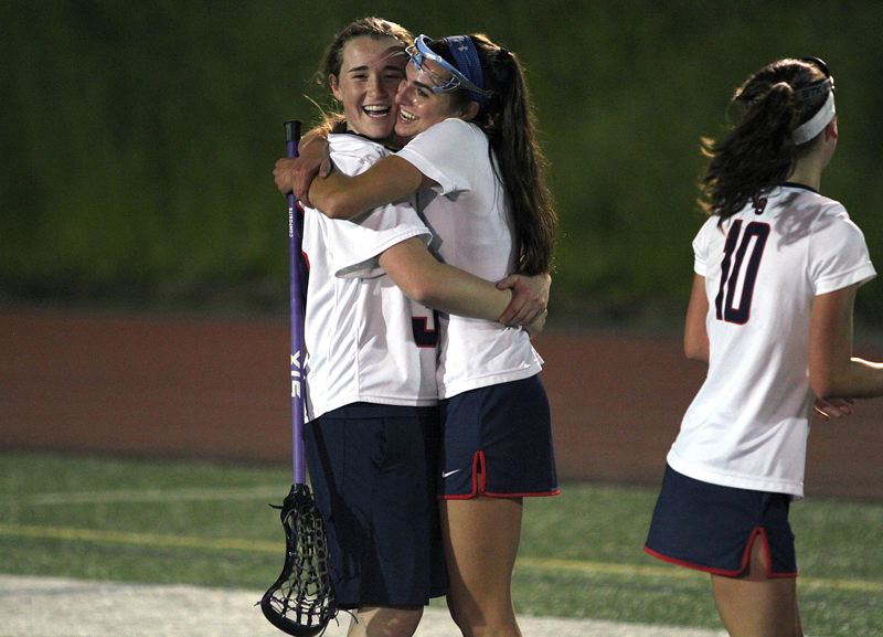 REVIEW FILE PHOTO - Lake Oswego's Riley Hertford (left) and Lauren Gilbert, here after the 2017 state championship game, were both named to the 2017 All-American team.