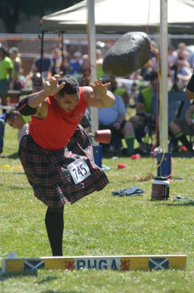 OUTLOOK PHOTO: CLARA HOWELL - Competitors toss a heavy stone to see how far it can go.