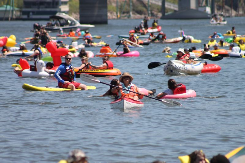 TRIBUNE PHOTO: LYNDSEY HEWITT - About 3,000 people took to the Willamette River in downtown Portland Saturday, July 15, for the annual Big Float. The party hosted by the Human Access Project, aims to get more people to use the river from downtown's new Poet's Beach.