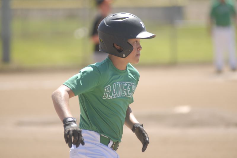 ESTACADA NEWS: MATT RAWLINGS - Estacada's Andrew Riedel rounds first base in the Rangers 12-2 win over Gladstone.