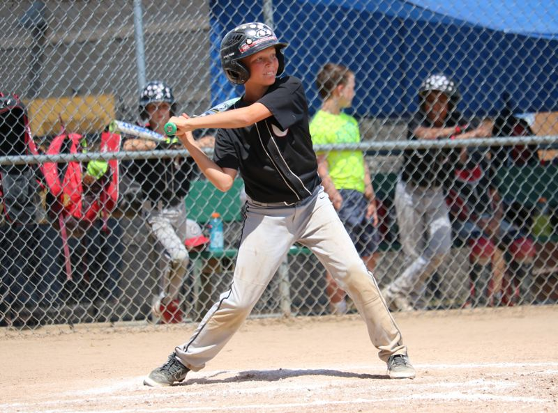 REVIEW/NEWS PHOTO: JIM BESEDA - Clackamas' Ashton Church had an RBI-double that scored Jack Kiesel in the fourth inning of Sunday's JBO Midget American championship final against Central.