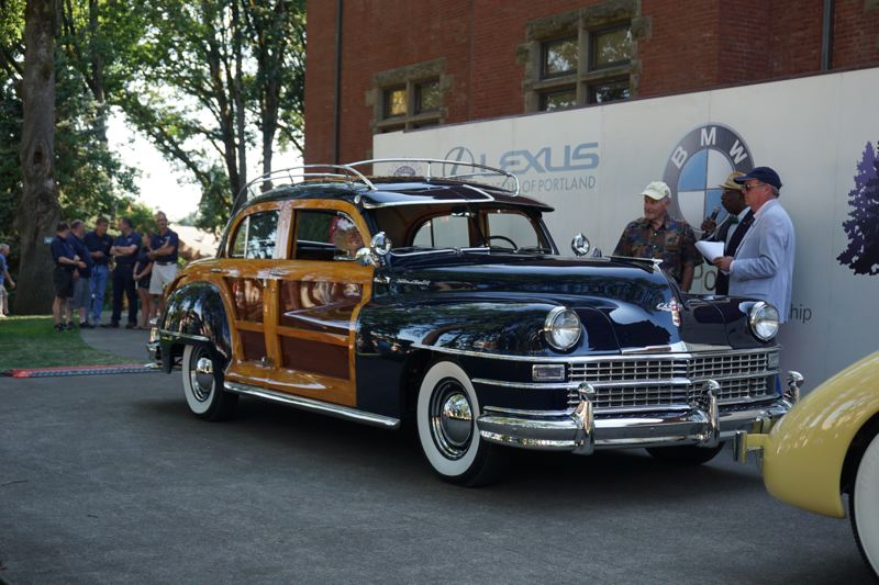 PORTLAND TRIBUNE: JEFF ZURSCHMEIDE - Woody vehicles of all types were featured at this year's concours, with this 1947 Chrysler Town & Country sedan taking the Best Closed Car award at the show.