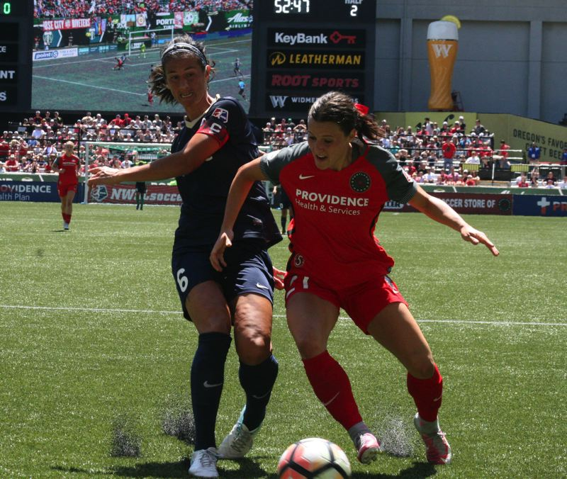 COURTESY: JODY LIM/ASIAN REPORTER - Hayley Raso (right) of the Portland Thorns fights Abby Erceg of the North Carolina Courage for the ball at Providence Park.