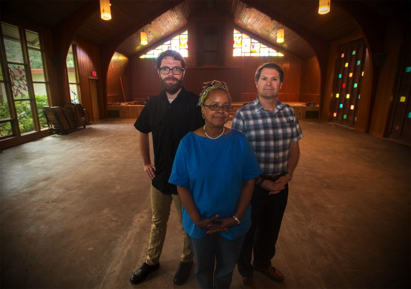 OUTLOOK PHOTO: JOSH KULLA - Pastor Adam Jenkins, LaVerne Lewis and Rev. Steven Lewis stand in the sanctuary of the former church that is being transformed into Rockwood Center.