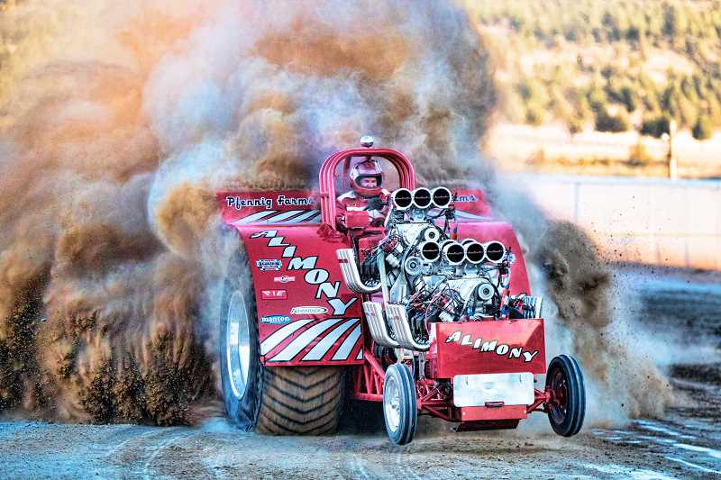 ALL PHOTOS LON AUSTIN/CENTRAL OREGONIAN - Photos of the second annual truck and tractor pull at the Crook County Fairgrounds