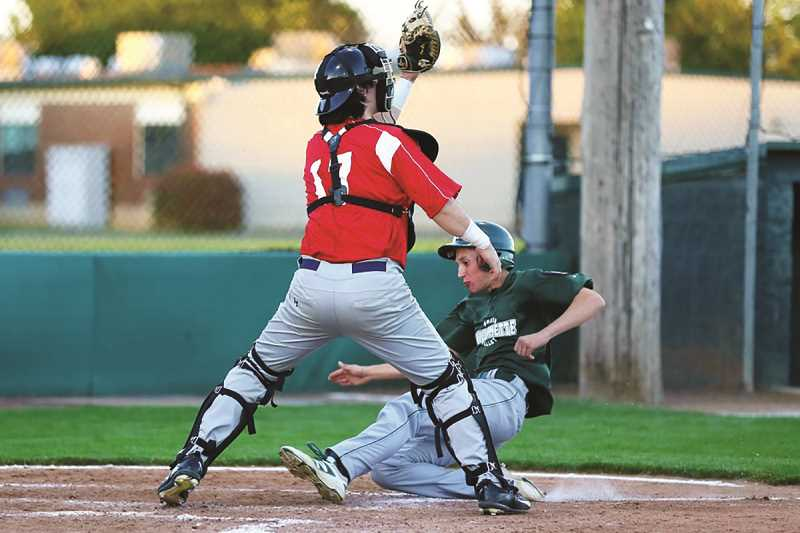 JO WHEAT - North Marion's Jesse Agnew slides under the tag to score at home.  Agnew is one of nearly two dozen teammates from North Marion High School to help give the program's Legion team a full roster without having to draw from other schools around the region.