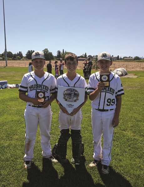 KRISTI VAN VLECK - North Marion Junior American pitchers (from left) Wil Van Vleck, Dawson Schrenk and Blaine Smith combined to allow just two runs in the Huskies' 7-2 victory over Silverton in the championship game of the county tournament on Sunday.