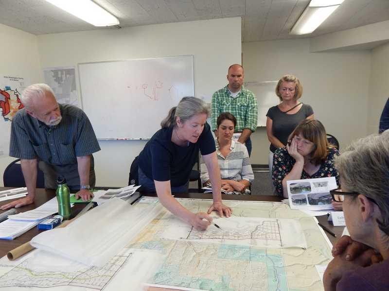 REGAL COURIER PHOTO BARBARA SHERMAN - At a July 10 meeting of the Stakeholder Advisory Committee at City Hall, Marcy McInelly (center) with urban design firm Urbsworks, points out a feature on a map showing the area that King City would like to bring into its urban growth boundary.