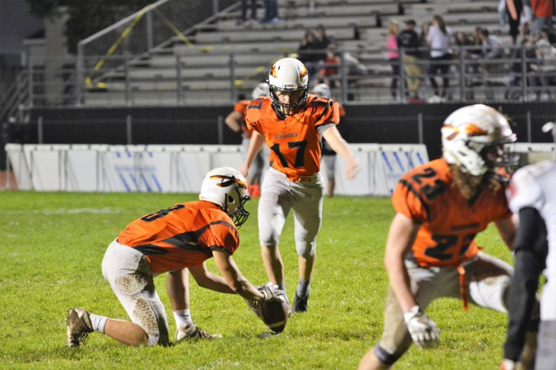 SPOTLIGHT PHOTO: JAKE MCNEAL - Indians senior Benji Davidson (17) lines up a kick in Scappoose's Class 4A play-in defeat of Douglas last fall.