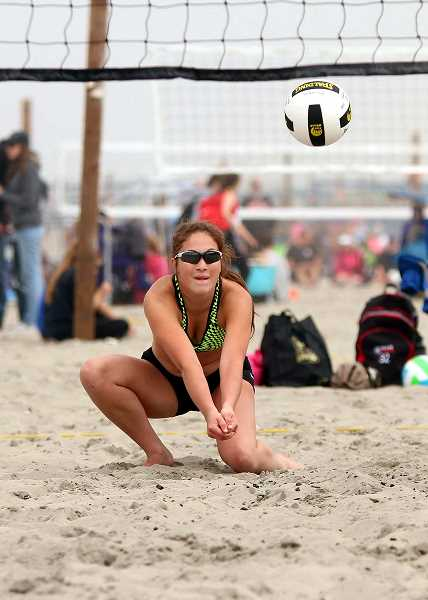COURTESY PHOTO - Forest Grove's Kinsey Barnett digs a ball during a beach volleyball tournament at Seaside earlier this summer.