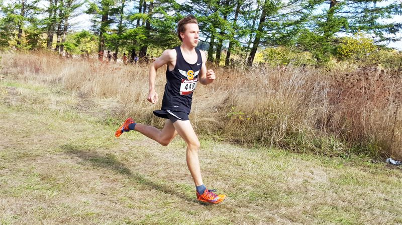 PHOTO CREDIT: SCAPPOOSE CROSS COUNTRY - Indians senior John Kavulich has a shot at his boys' first-ever individual state championship after coming up second by four seconds last fall.