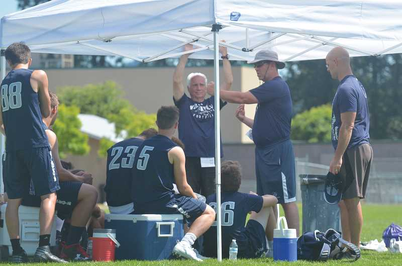 SPOKESMAN PHOTO: COREY BUCHANAN - Wilsonville head coach Adam Guenther talks to his players at the Tigard Passing Day Saturday, July 15.