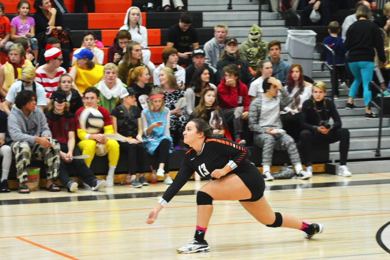 SPOTLIGHT PHOTO: JAKE MCNEAL - Scappoose senior setter Ashley Oakland swoops for a save last fall.