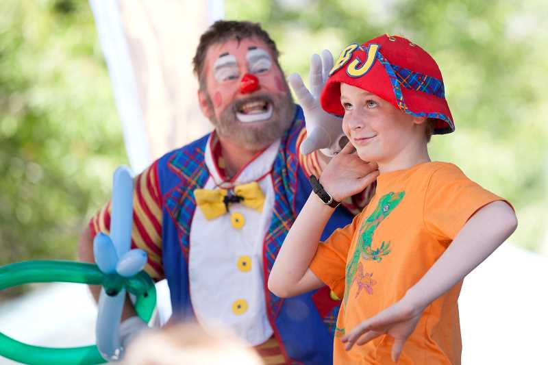 PAMPLIN MEDIA GROUP: JAIME VALDEZ - Jared Istock,11, of Rock Creek, does his impersonation of BJ The Clown on the family stage during the 2017 Robin Hood Festival.