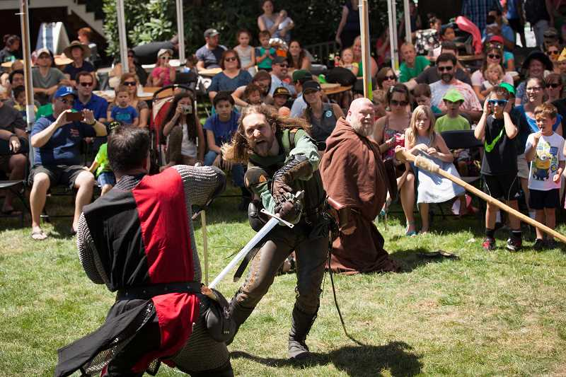 PAMPLIN MEDIA GROUP: JAIME VALDEZ - Actors from the Seattle Knights entertain children with a sword fight during the 2017 Robin Hood Festival. Photo by Jaime Valdez