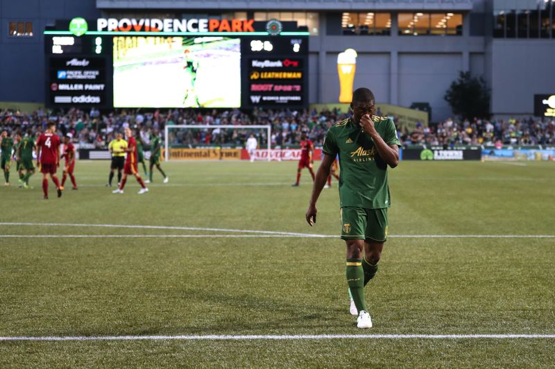 TRIBUNE PHOTO: JAIME VALDEZ - Portland Timbers forward Fanendo Adi walks off the pitch after being ejecting for a confrontation with Real Salt Lake midfielder Kyle Beckerman in the second half Wednesday at Providence Park.