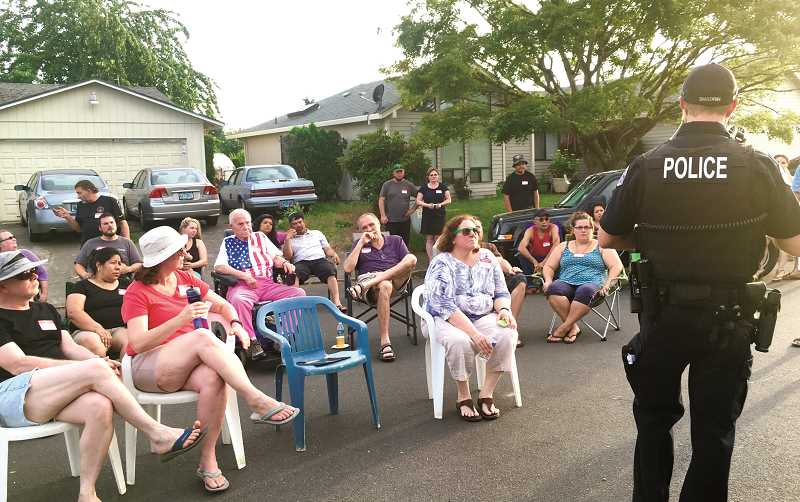 COURTESY PHOTO - National Night Out encourages neighborhoods to invite police officers to a block party, similar to this neighborhood group meeting in east Woodburn last summer.