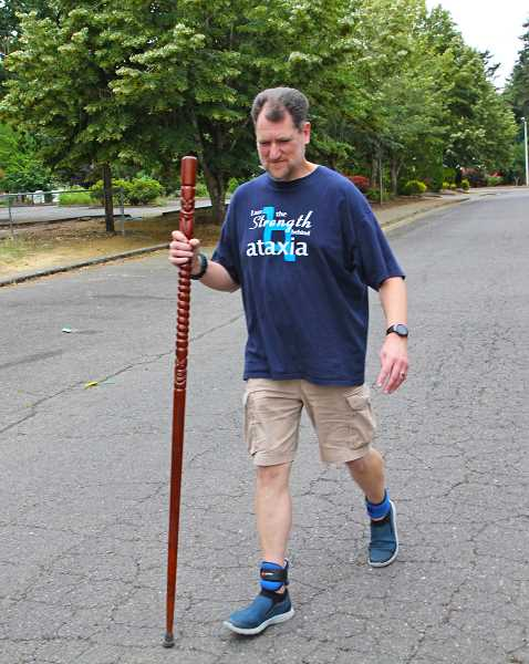JULIA COMNES - Woodburn resident Jason Wolfer is coming closer to his goal of walking 60 miles for ataxia research this summer.